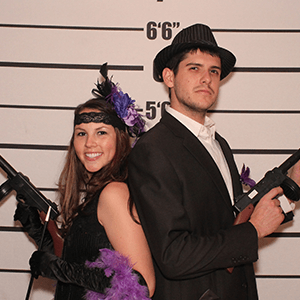Milwaukee Murder Mystery party guests pose for mugshots
